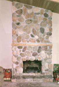 river rock stone fireplace with granite hearth and ponderosa pine long mantle
